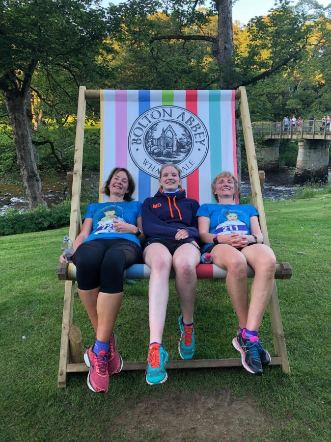 Airecentre Pacerss' runners Cath Tindall, Megan Dennison and Susan Dennison relax after completing the Bolton Abbey Solstice Saunter