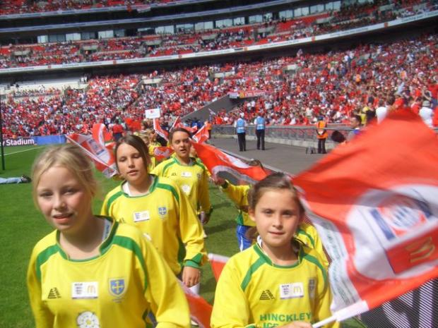 Guiseley AFC Juniors girls parade round at Wembley Stadium before the Community Shield game