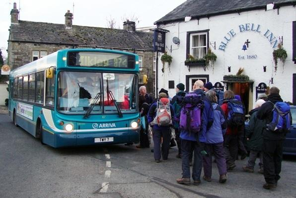 Dales Way walkers catching DalesBus 874 outside the Blue Bell Inn, Kettlewell. Photograph Friends of DalesBus