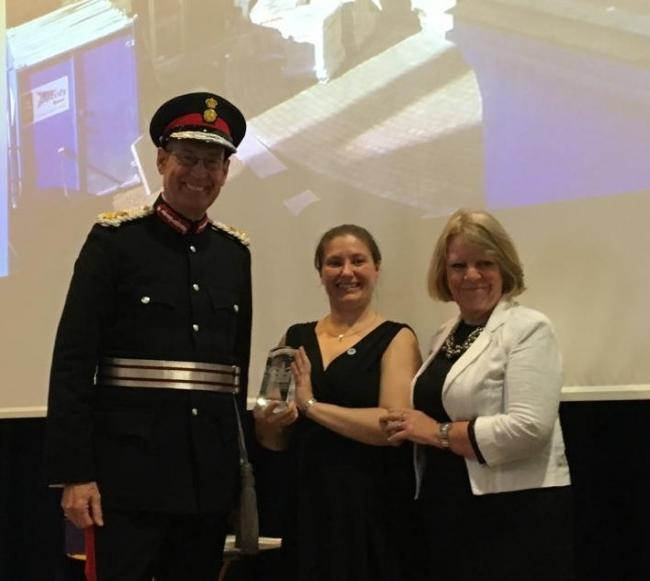 Lord-Lieutenant of West Yorkshire Ed Anderson presenting the Queen's Award to Laura Kox and Jean Crawford at Otley Courthouse