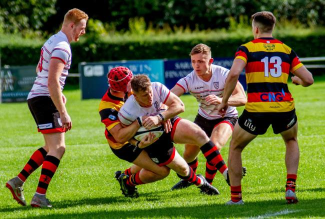 Action from Ilkley's (white shirts) 38-7 defeat to Harrogate in the North Premier. Picture: ruggerpix.com