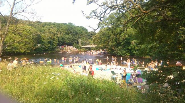 Bathers pictured on the River Wharfe on July 25, 2019