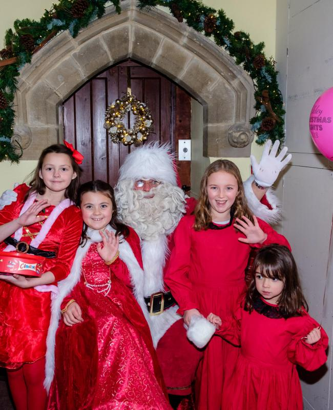Santa and his helpers await visitors in Christchurch Hall at the Ilkley Christmas Lights Switch On last year. Ellie (aged 9) and Maddie (aged 8) Jennings. With Heidi Dickinson (aged 10) and Betsy Jennings (aged 4).