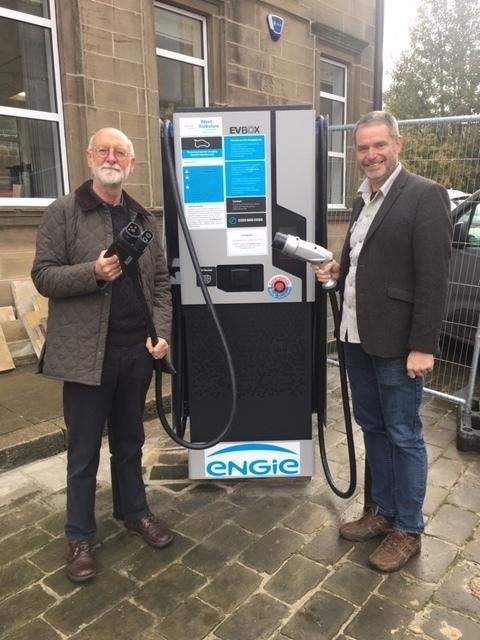 Cllrs Colin Campbell and Ryk Downes with the charging point at Yeadon