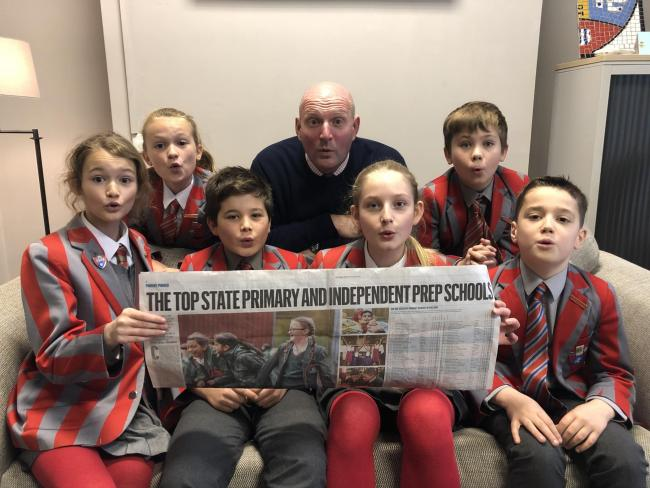Big oo's from Ghyll Royd Head David Martin and Form 6 children as they see their School's ninth place national ranking