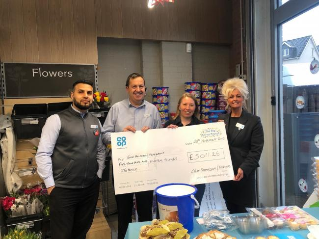 Mohammed Hafiz and Ian Brown from Ilkley Foodstore, playgroup leader Tracy Fearnley, and Alison Medd from Ilkley Funeralcare.