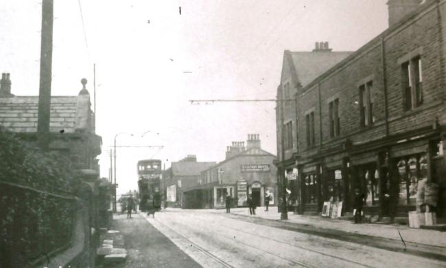 This undated photograph from Aireborough Historical Society shows a tram on Otley Road in Guiseley.