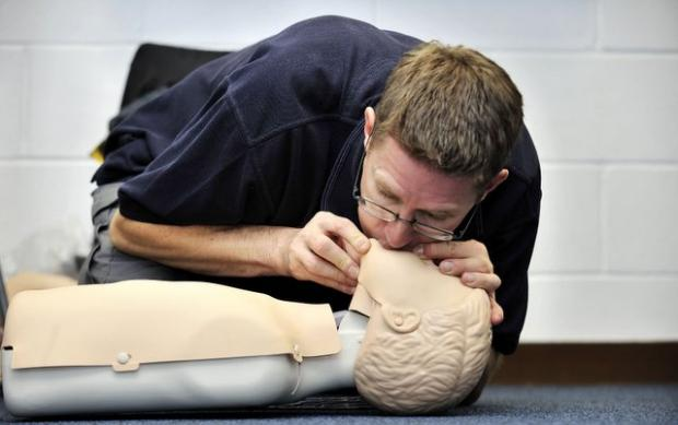 Chris Leleux demonstrates first aid on a mannequin