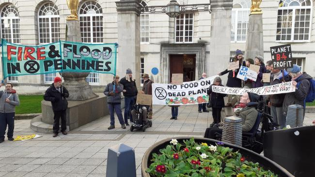 Anti-climate change protesters outside Civic Hall, Leeds on Monday