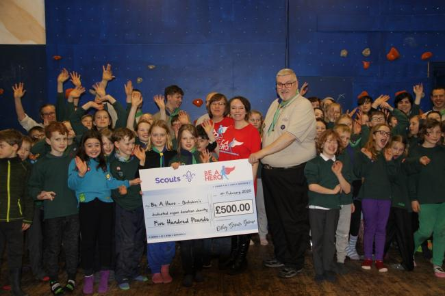 2nd Otley Scouts presenting their donation to the Be A Hero team