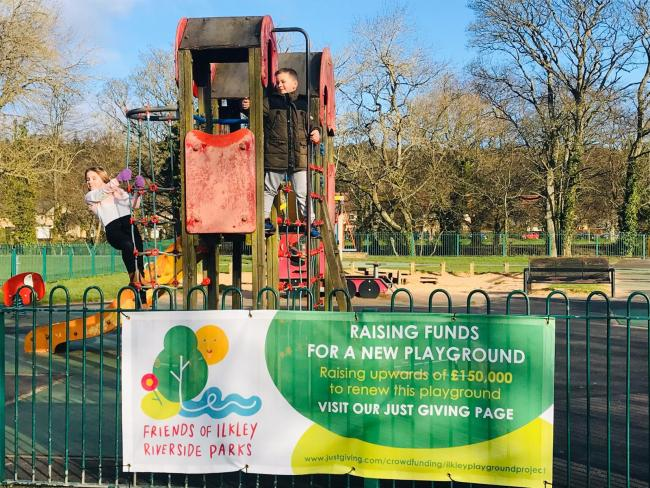 Children play in the Riverside Park in Ilkley where banners have gone up promoting a £200,000 fundraising appeal for new play equipment