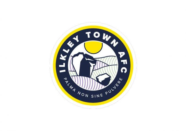 "Ilkley Town's new badge has an image of the Cow and Calf rocks and retains the motto ""No Reward without effort"""