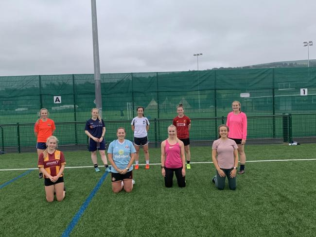 Nine of the Ilkley Ladies Football team who have worked on the front line during the pandemic. Back row: Annie Postlethwaite, Hanna Spivey, Jade Cubitt, Olivia Boardman, Chloe Dinsdsle. Front row: Lily Gazenley, Becky Gill, Lauren Oxtoby, Beth Hirst. Not