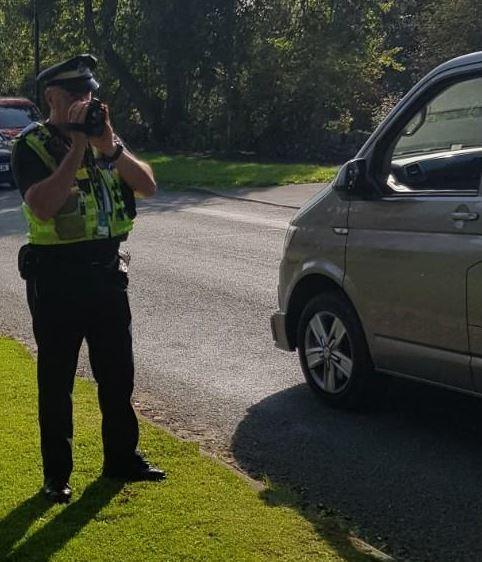 A police officer checking traffic speed in Guiseley