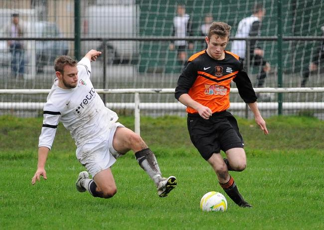 Sam Murphy (right) scored twice for Oxenhope in their win over Aberford Albion Picture: Anthony McMillan
