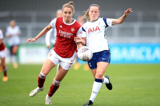 Arsenal's Vivianne Miedema (left) battles with Tottenham's Anna Filbey during a 6-1 win in which she scored a hat-trick and set a WSL scoring record.
