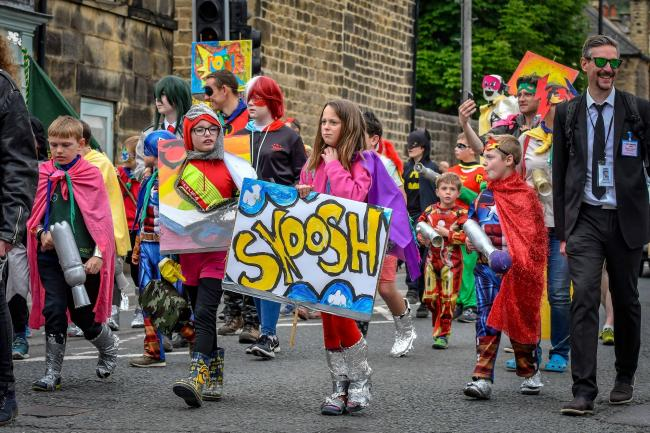 Superheroes marching in the 2019 Otley Carnival parade