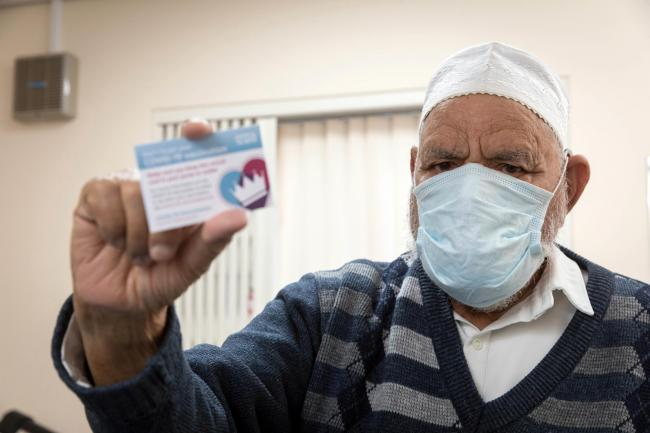 Mohammed Bostan, 95, after receiving his Covid-19 vaccination at Long Lee Surgery