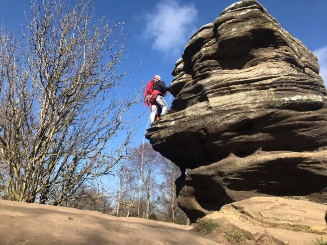 A man is helped at Brimham Rocks. Picture UWFRA