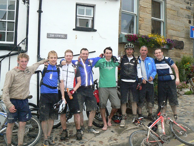 Coast to coast cyclists Daniel Bryan, Chris Normington, Ian Thomas, James Todd, Richard Bryan, Matthew Willetson, Paul Bryan and Andrew Callaghan raised £2,000 for charity BASIK.