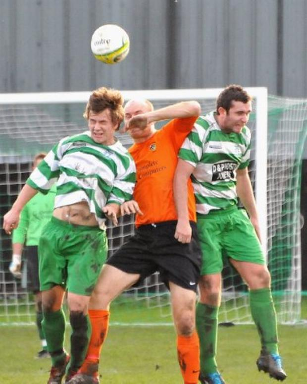 Otley's Rob Carr tussles with  Danny Cunningham and Lee Burges