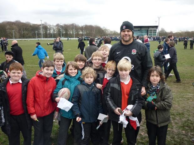 Youngsters from Bramhope Primary pose with England rugby union international Tom Palmer