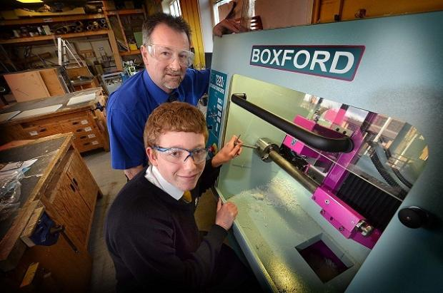 Guiseley School has a new mini-lathe which was being tested for the first time by pupil Oliver Robinson (seated) with the help of trainer Steve Bowers