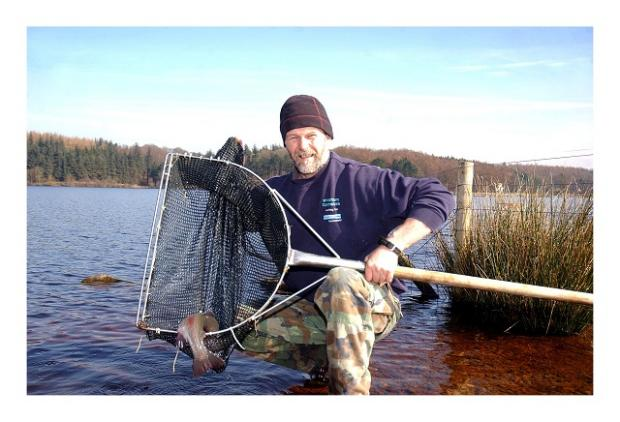 Wharfedale Observer: Warden Colin Winterburn shows off one of the latest recruits to the reservoirs