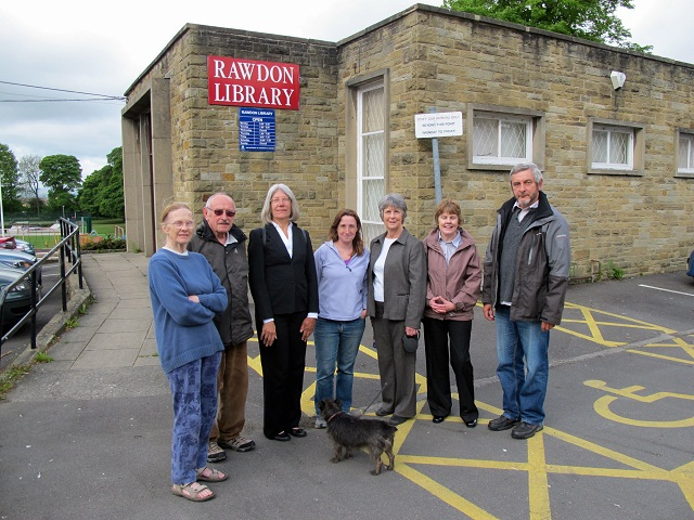 Friends of Rawdon Library stand outside the building they are trying to save