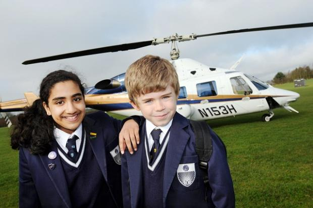 James O'Malley, from Pool, with Vidya Premraj, from Adel, with the helicopter