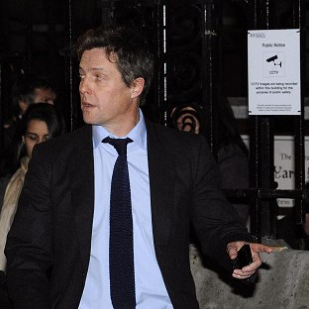 Hugh Grant says he hasn't had to bluff when it comes to his excitement about being a dad