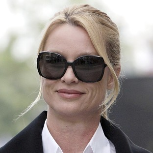 Nicollette Sheridan arrives at court in Los Angeles (AP)