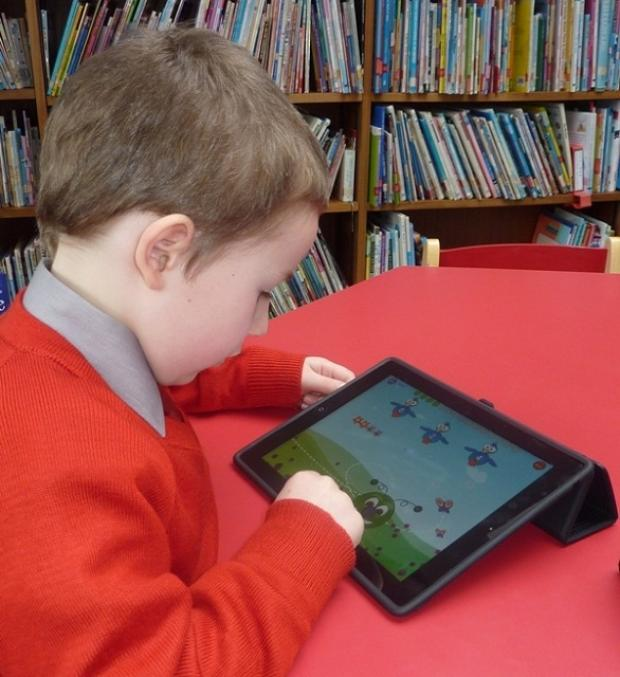 Pupil Nathan Radbourne uses one of the iPads at Froebelian School