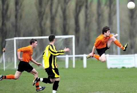 High-flying Tom Chadwick clears for Otley Town