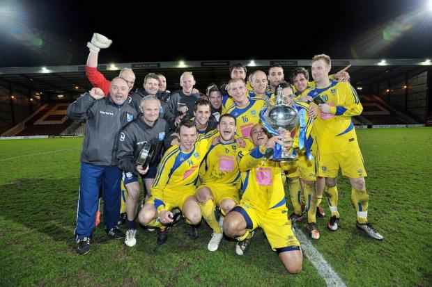 Joyful Guiseley players celebrate their cup final victory over Avenue