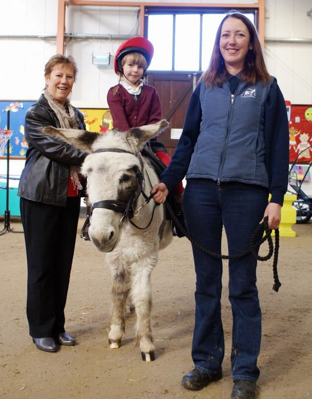 Otley Show secretary Janet Raw with Evie Mitchell – on William D – and  an instructor at the Elisabeth Svendsen Trust For Children And Donkeys' Leeds Centre