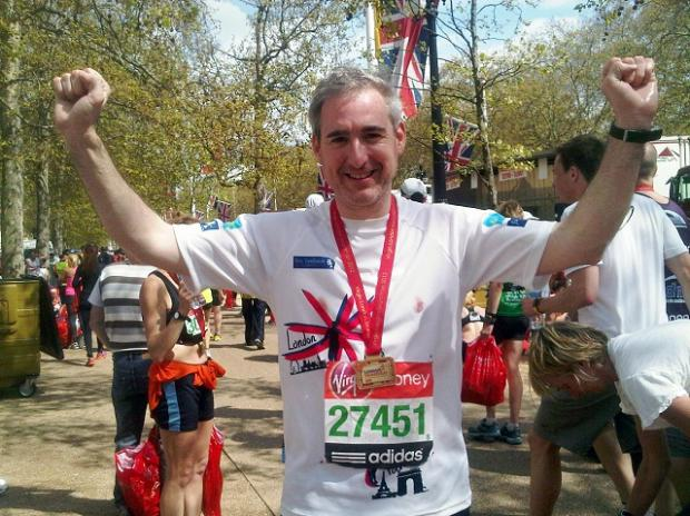 MP Greg Mulholland  at the      finish line of the London Marathon, having completed the 652-mile Jane Tomlinson tenth Anniversary Challenge
