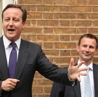 Labour has demanded David Cameron appear before MPs to answer questions about Jeremy Hunt