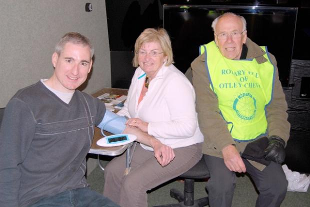 MP Greg Mulholland with nurse practitioner Margaret Liptrot and Rotary Club of Otley Chevin member Harvey Meggitt, at the free blood pressure checks event