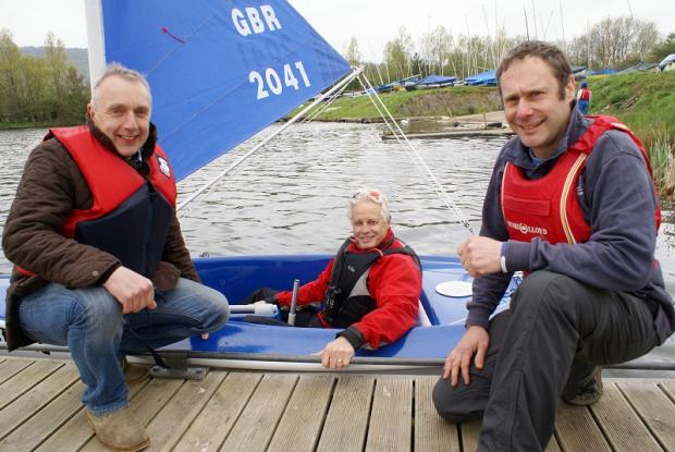 Regional manager of the Building & Engineering Association Neil Ashford, left, with Otley Sailing Club instructor Peter Fox and commodore Matt Thomas