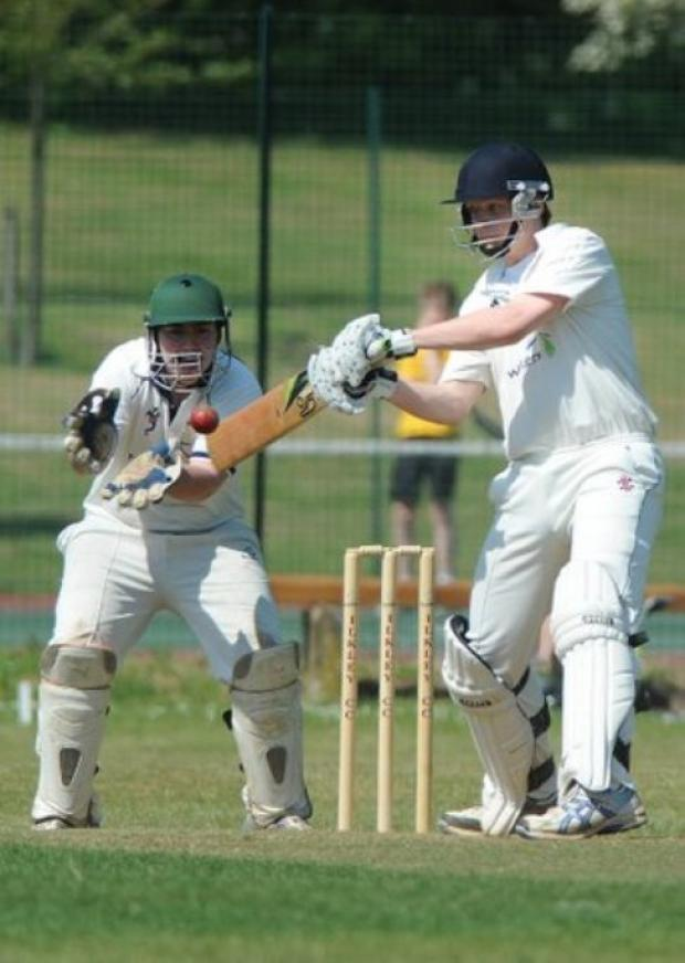 Ilkley batsman Rob Spivey looks to cut the ball through the offside as Rawdon's wicketkeeper Matthew McCallum keeps a close eye.