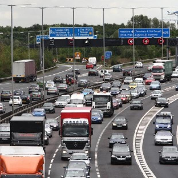 Two men have been arrested after a motorist drove the wrong way round the M25 in a police car chase