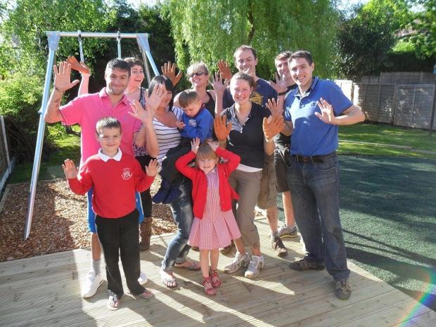 James Harte in the garden with his family and some of the volunteers