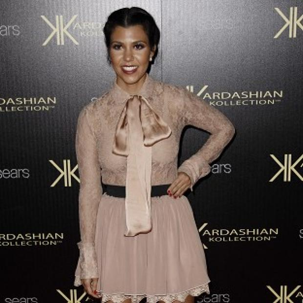 Kourtney Kardashian is thought to be in labour with her second child