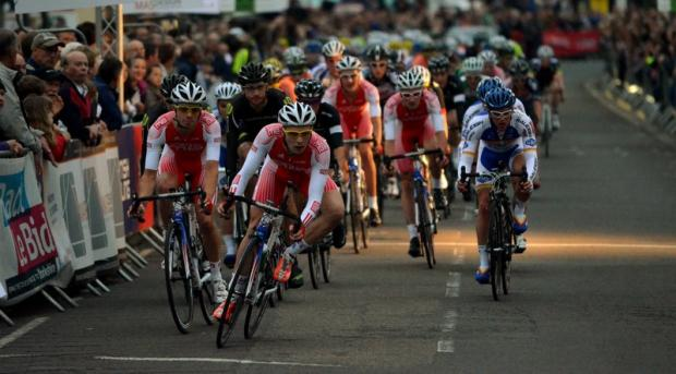 A shaft of light pierces the gloom during the MAS Design Elite Cycle Race and National Circuit Race Championship last night at Otley