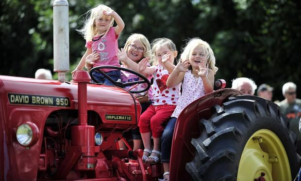 Flashback to last year's Burley summer festival, with Freya-Mae Barber, three, Amelia-Rose Barber, seven, Daisy Downs, four, and five-year-old Madison-Grace Barber on a tractor