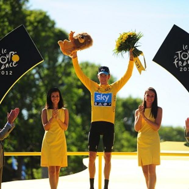 Bradley Wiggins celebrates winning the Tour de France