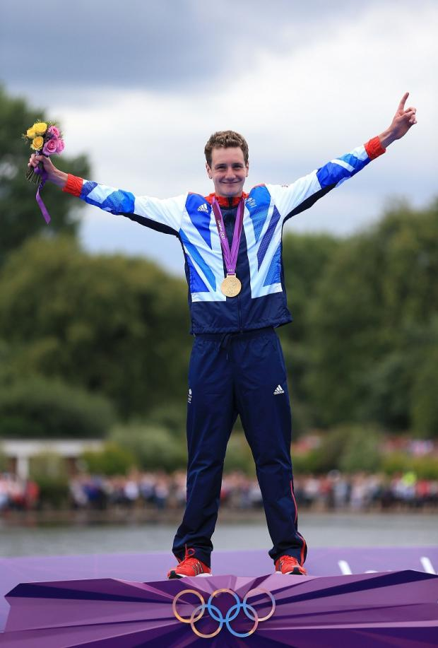 Alistair Brownlee beams with pride after being presented with his gold medal
