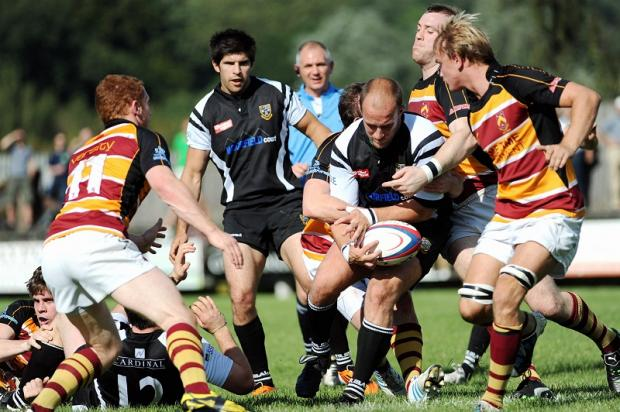 Otley's director of rugby Tom Rock drives forward