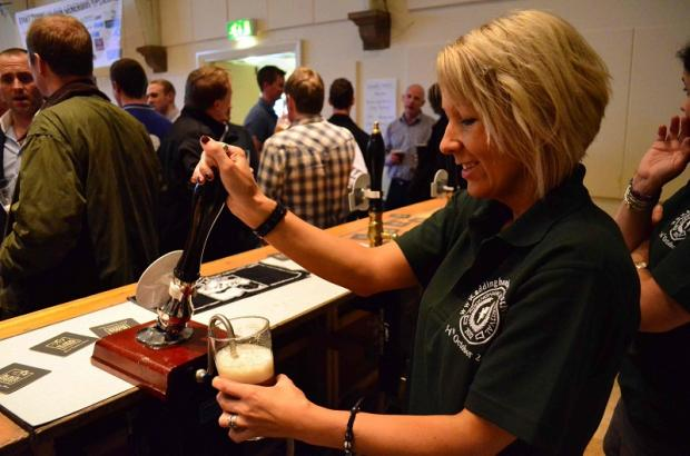 Jen Thomson serving on one of the Addingham Beer Festival pump bars
